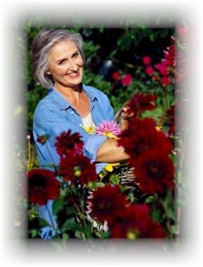 Happy Older Woman Picking Flowers